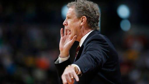 Iona head coach Tim Cluess directs his team against Iowa State.