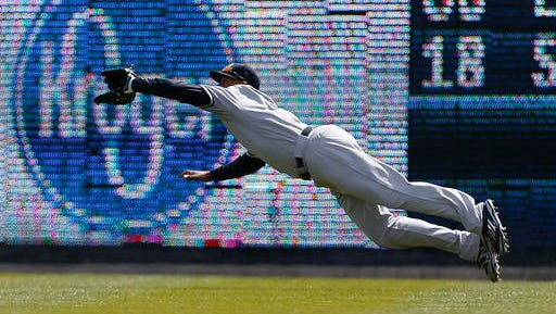 New York Yankees center fielder Aaron Hicks (31) makes a diving catch on a Detroit Tigers' Miguel Cabrera (24) fly ball in the third inning of a baseball game, Friday, April 8, 2016, in Detroit.