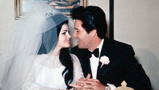 """FILE - In this May 1, 1967, file photo, singer Elvis Presley and his bride, the former Priscilla Beaulieu, appear at the Aladdin Hotel in Las Vegas, after their wedding. Priscilla Presley opened up about her life with Elvis during a Nov. 16, 2016, interview on British chat show, """"Loose Women,"""" on the ITV network."""