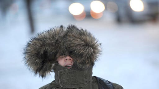 Kasim Kantarevic, 12, keeps his hood up as he walks to school on Thursday, Dec. 15, 2016  in Erie, Pa.  Much of the northern Mid-Atlantic and Northeast will stay cold for the next couple of days as the arctic air remains stuck over the northern Appalachians, the National Weather Service said.