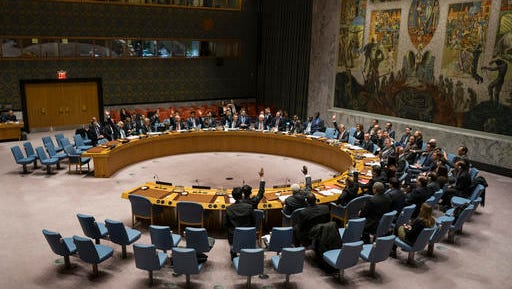 Members of the United Nations Security Council vote at the United Nations headquarters on Saturday, Dec. 31, 2016, passing a resolution supporting efforts by Russia and Turkey to end violence in Syria and jumpstart peace negotiations.