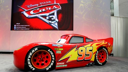 """FILE - In this Jan. 8, 2017 file photo, a vehicle based on the Lightning McQueen animated character from the Disney Pixar """"Cars"""" franchise is unveiled during a news conference at the North American International Auto Show in Detroit.  A life-size replica of the """"Cars"""" character and his pals Cruz Ramirez and Jackson Storm are revving up for a 27 city tour across the United States in advance of the June 16 release of """"Cars 3."""" The Walt Disney Company said Tuesday that the Road to the Races tour kicks off Thursday at Walt Disney World."""