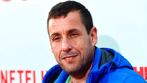 "FILE - In this May 16, 2016 file photo, Adam Sandler, a cast member in ""The Do-Over,"" poses at the premiere of the film in Los Angeles. Netflix has extended its deal with the comedian for four more feature films. As part of a previous four-movie deal, Sandler has already produced and starred in two films for Netflix. While neither ""Ridiculous 6"" nor ""The Do-Over"" received anything close to good reviews, Netflix said Friday, March 24, 2017, they are the biggest film releases for the service. Sandler's next Netflix film, ""Sandy Wexler,"" debuts on April 14."