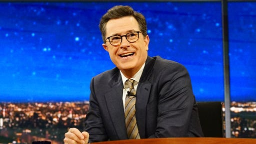 """In this March 31, 2017 photo released by CBS, host Stephen Colbert appears on """"The Late Show with Stephen Colbert"""" in New York. Colbert won in the Nielsen company's ratings for the ninth consecutive time last week, his margin of 400,000 viewers the widest lead since the CBS star overtook Fallon with a sharp concentration on politics. Fallon aired a rerun Friday, otherwise the shows were all fresh last week."""