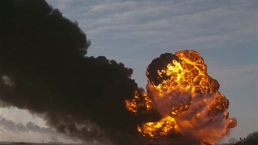 FILE - In this Dec. 30, 2013 file photo, a fireball goes up at the site of an oil train derailment in Casselton, N.D. North Dakota's Industrial Commission is considering new rules that could require oil companies to reduce the volatility of crude before it's loaded onto rail cars. The Department of Mineral Resources is slated to make a proposal Thursday, Nov. 13, 2014, that may require companies to remove certain liquids and gasses from oil train shipments, a process some say would make such transport safer. (AP Photo/Bruce Crummy, File)