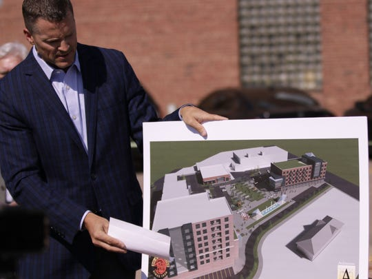 Mayor Paul TenHaken shows the initial plans for the first development at 8th and Railroad in downtown Sioux Falls, SD, July 16, 2018