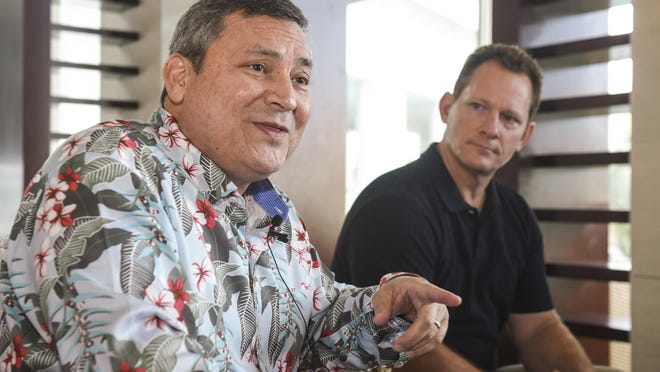 Gov. Eddie Calvo, left, with Lt. Gov. Ray Tenorio, talks about how the government has managed to identify a $10 million surplus in the General Fund from the past fiscal year during an impromptu press conference at the Sheraton Laguna Guam Resort on Wednesday.