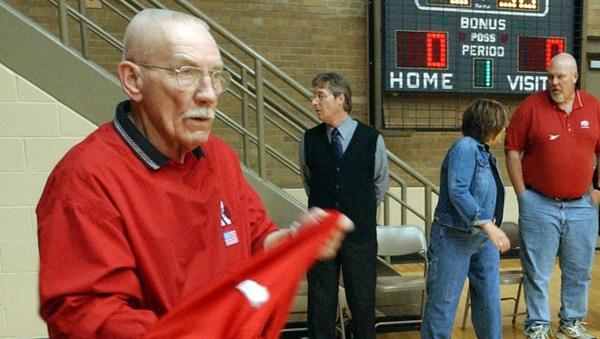 Bob Wettig  folds basketball warmups prior to Richmond's basketball game at Muncie Central High School on March 5, 2004.