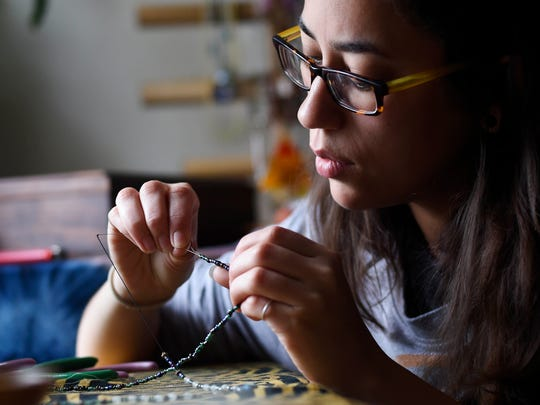 Sierra Aleman, creator of The Meraki Collective, makes a neclace at her home studio. The Meraki Collective will be one of over 40 vendors selling goods at York Flea.