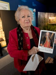 Spanish Consul Maria Davis holds a photo from a magazine that was the inspiration for a new painting of Gen. Galvez.
