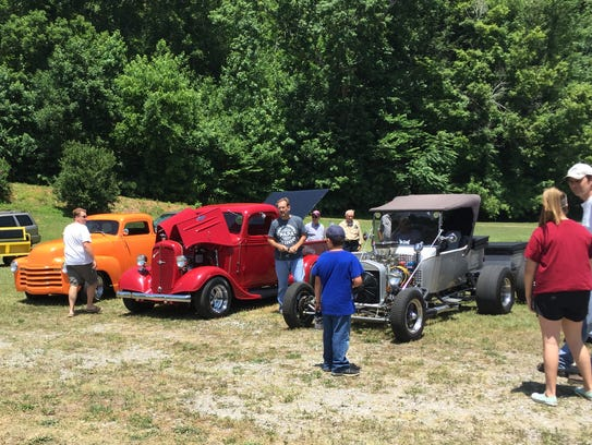 A variety of vehicles and people attended the second