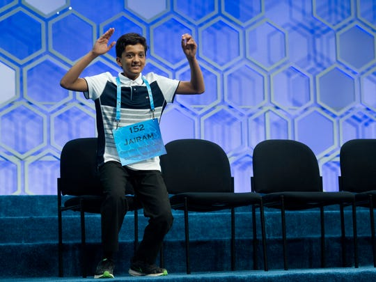 Jairam Jagadeesh Hathwar, 13, of Painted Post, N.Y., celebrates after being named the co-champion of the Scripps National Spelling Bee in National Harbor, Md., Thursday, May 26, 2016. (AP Photo/Cliff Owen)