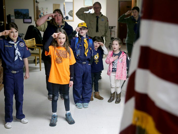 The girl's den Scout Pack 5239 in West Bremerton salutes