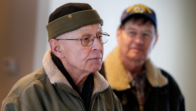 Jerry Monson, a disabled veteran, visits his new house in Appleton Wednesday with John Gillespie.