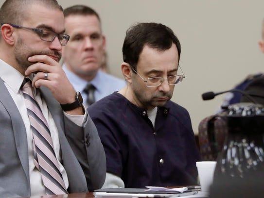 Larry Nassar sits with attorney Matt Newburg during