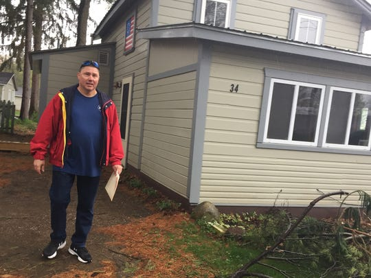 Tom Miller, now a resident of Mississippi, on Monday stands in front of a rental cabin he once owned Lone Birch Street, a stone's throw from Malletts Bay. Miller sold his home for $105,000 in 2003. Photographed May 1, 2017