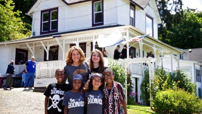 "This June 2014 photo shows Devonte Hart with his family at the annual celebration of ""The Goonies"" movie in Astoria, Ore. Authorities in Northern California say they believe all six children from a family were in a vehicle that plunged off a coastal cliff."