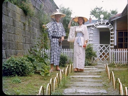 Gerry and Mary Deppe take a portrait outside their home in Japan in traditional Japanese garb.