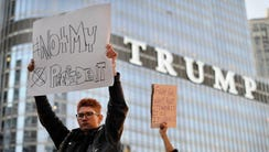 People take part in a protest near the Trump tower,