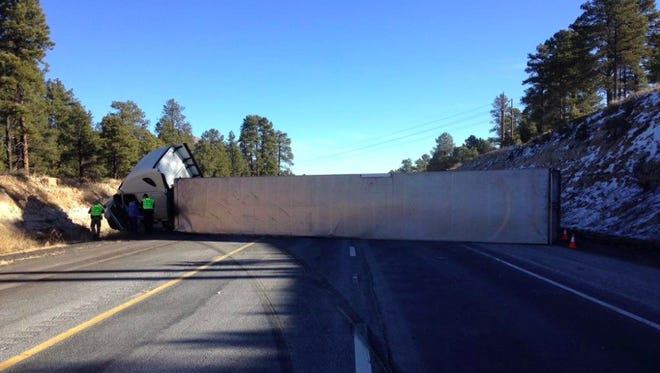 An overturned big-rig shut down all lanes of traffic of eastbound Interstate 40 in Flagstaff on Jan. 27, 2018, but authorities were allowing motorists to pass on the shoulder because of the long delays.