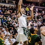 MSU's Tum Tum Nairn, left, lays the ball in against Northern Michigan.