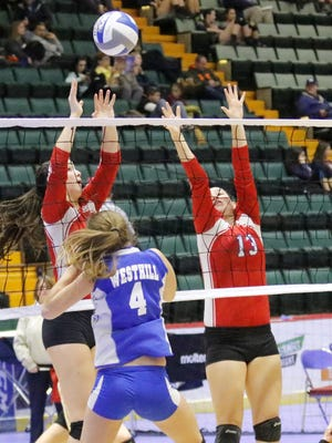 Owego Free Academy's Bella Coleman, left, and Savannah Terry go up for a block in front of Westhill's Bridget Lougen on Saturday during a girls volleyball Class B pool-play semifinal match at Glens Falls Civic Center.