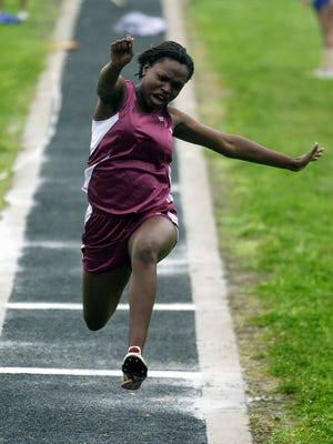 Henderson County's Olivia Joseph competes in the triple jump during a meet at Colonel Stadium during the 2004 season.
