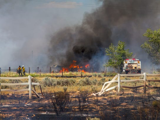 A fire burns along Coal Creek Road in Cedar City, June