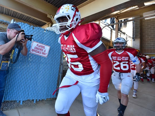 Monalo Caldwell of Colerain leads the West to the field Thursday, June 8th at Kings High School 2017 SWOFCA East/West All-Star Football Game