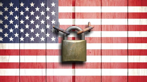 U.S. flag with a padlock keeping it shut.