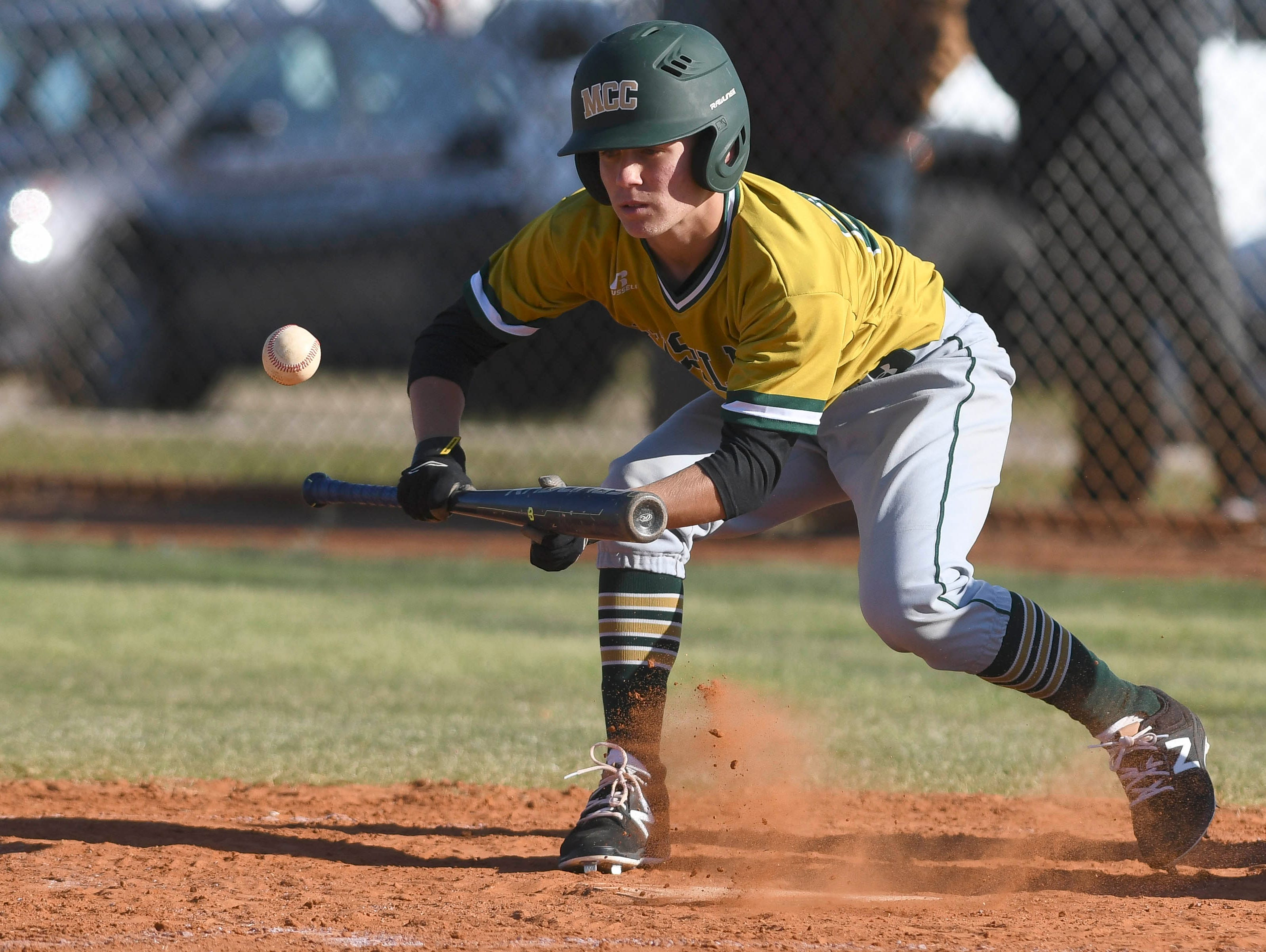 Melbourne Central Catholic's Cam Marzuzzella (26) attempts a bunt during Thursday's game in Melbourne.