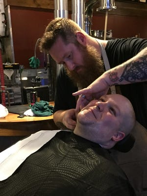 Reporter Will Cleveland gets a shave Tuesday to kick off Movember at a joint fundraiser organized by Swiftwater Brewing and Bauman's Barbershop.