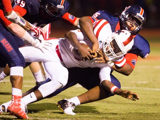 Belton-Honea Path's Tysheik Galloway (65) tackles Palmetto's