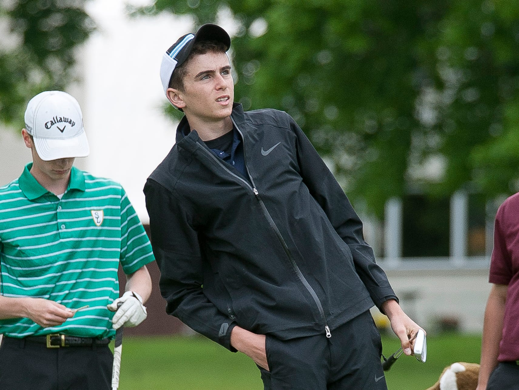 Kohler's Charlie Twohig watches his shot off the tee during Wednesday's WIAA Division 3 regional golf meet at the Town and Country Club in Sheboygan.