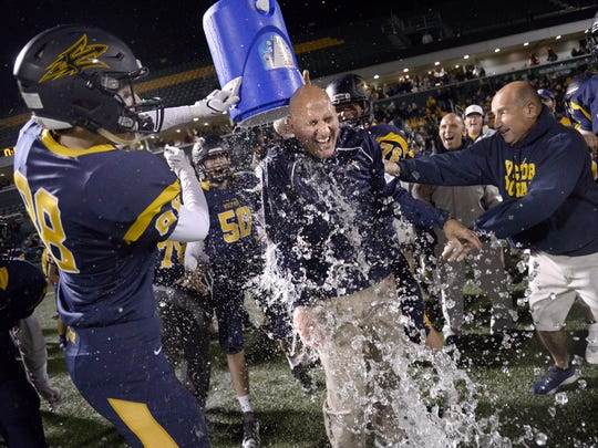 Victor head coach Geoff Mandile gets doused by Graham Seibold,