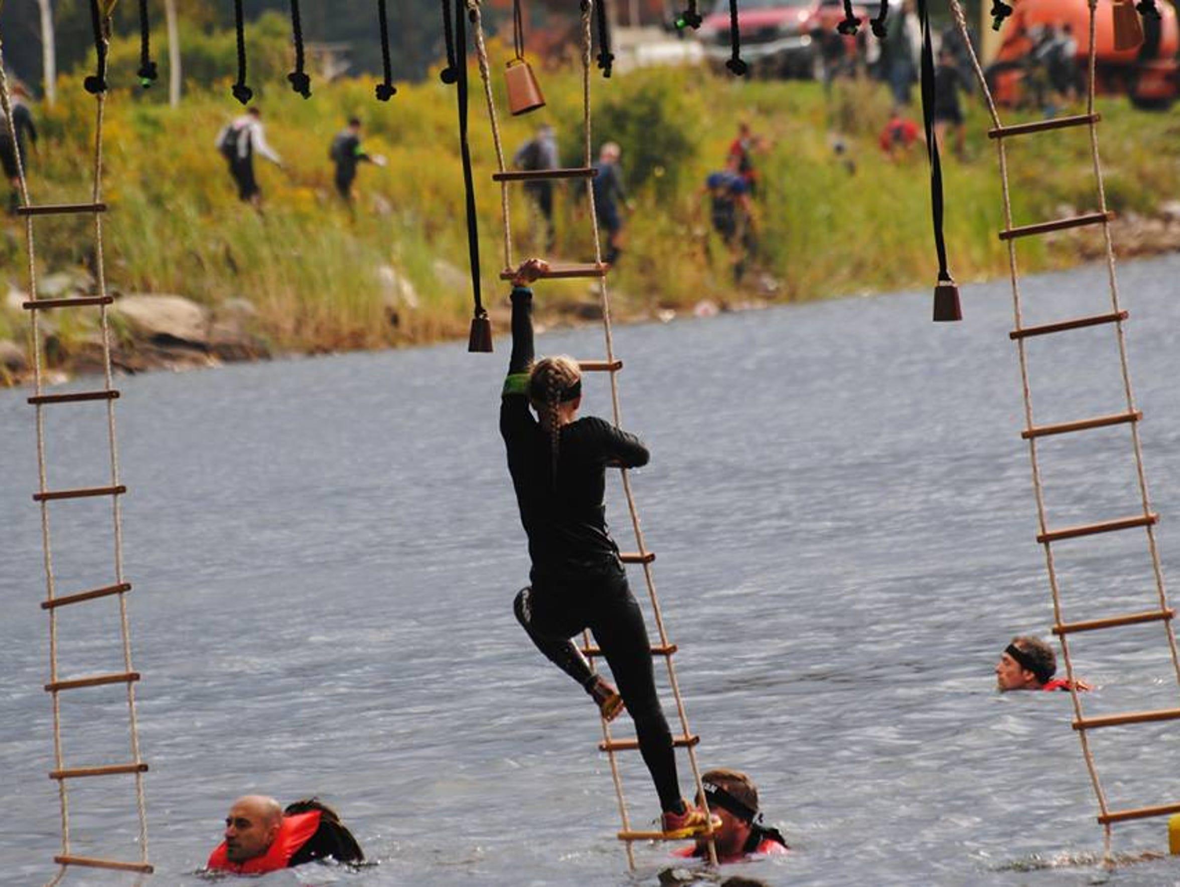Winter Vinecki seen here climbing up a rope ladder
