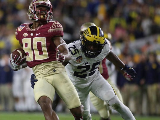 Nyquan Murray tries to evade a tackle during FSU's win over Michigan.