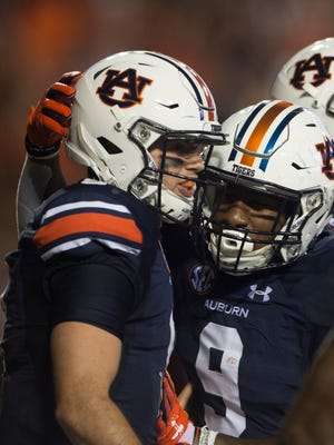 Auburn quarterback Jarrett Stidham (8) celebrates with Auburn running back Kam Martin (9) after scoring a touchdown during the NCAA football game between Auburn vs. Georgia Southern on Saturday, Sept. 2, 2017, at Jordan Hare Stadium in Auburn, Ala.