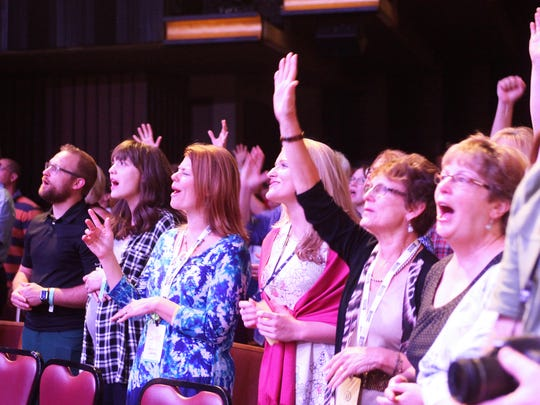 Sing! conference attendees participate in a hymn singalong at the Opry House in Nashville.