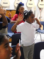 Students in Melissa Carlson's music class learn about music creation and performance.