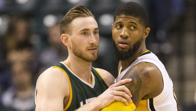 Gordon Hayward (left), of the Utah Jazz, works against Paul George of Indiana, during second half action at Indiana Pacers, Bankers Life Fieldhouse, Indianapolis, Monday, March 20, 2017. Indiana won 107-100.