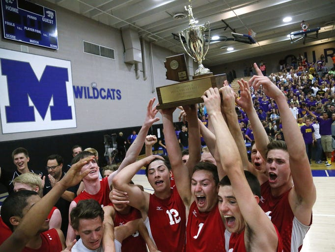 Boulder Creek players celebrate their Division I boys volleyball state championship over Mesa High on Saturday, May 17, 2014 in Gilbert. Boulder Creek won 3-1.