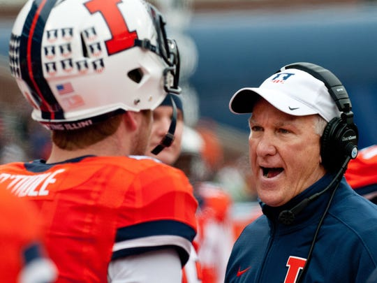 FILE - In this Nov. 22, 2014, file photo, Illinois offensive coordinator Bill Cubit talks to quarterback Reilly O'Toole (4) during an NCAA football game against Penn State in Champaign, Ill. Cubit has been named interim coach as Illinois abruptly fired head coach Tim Beckman one week before the start of the season Friday, Aug. 28, 2015, after an investigation of player mistreatment allegations revealed he had meddled in medical issues and inappropriately treated athletes who remained on scholarship after leaving the team. (AP Photo/Bradley Leeb, File)