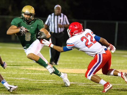 Iowa City West's Oliver Martin (8) jukes Cedar Rapids Washington's Tavian Patrick (22) during the first half of play in Iowa City on Friday, September 11, 2015. (Justin Torner/Freelance for the Press-Citizen)