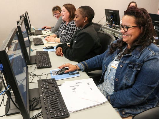 AnMed Health employee Lauren Ramkissoon, right, learns about the hospital system's new recordkeeping in a training class Thursday.