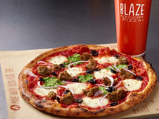 Custom-made pizzas are about $8 at Blaze Fast Fire'd Pizza.