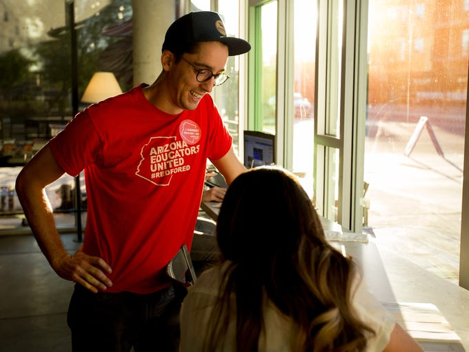 Andrew Pucci talks to a voter about the #RedforEe movement
