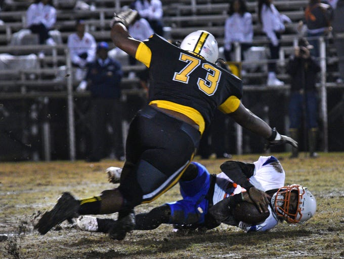 Kentwood's Ed Magee is knocked down by Haynesville's