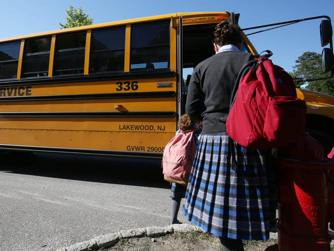 A school bus picks up students in Lakewood, New Jersey.