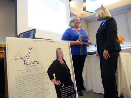 Emily Turnure (left), administrative director of Education